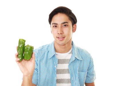 Smiling Asian man with vegetables 版權商用圖片