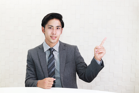 liveliness: Businessman pointing with his finger