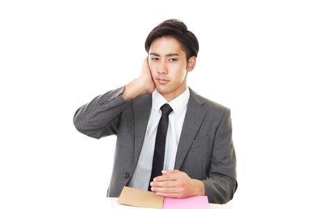 uneasy: Uneasy Asian businessman