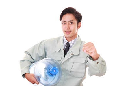 Worker with a container of water