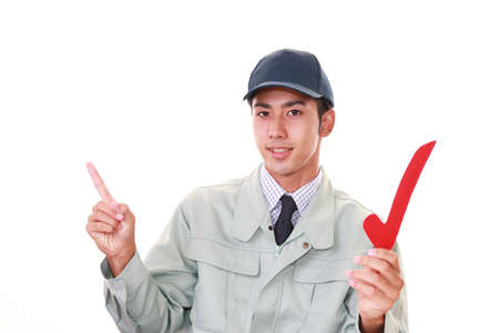 liveliness: Asian worker with a check mark