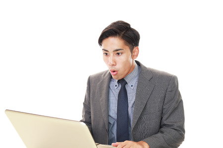 tired businessman: Surprised Asian businessman