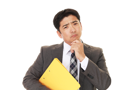 tired businessman: Portrait of businessman looking uneasy Stock Photo