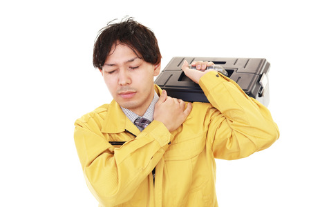 uneasy: Worker with shoulder pain
