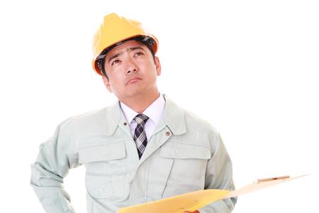 uneasy: Uneasy Asian worker