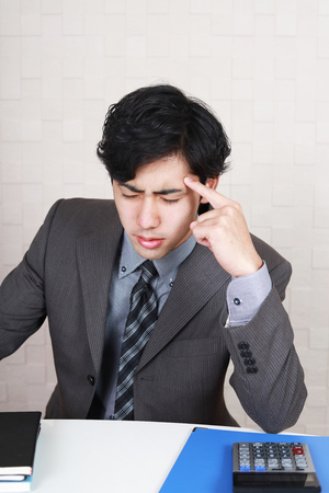 tired businessman: Tired and stressed Asian businessman