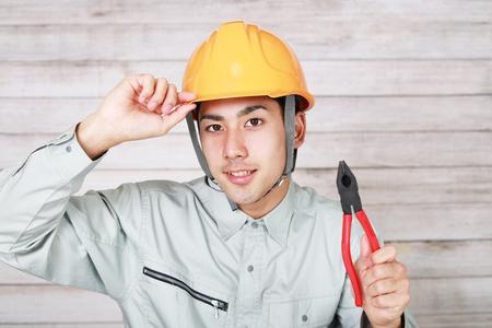 アジア人労働者を笑顔