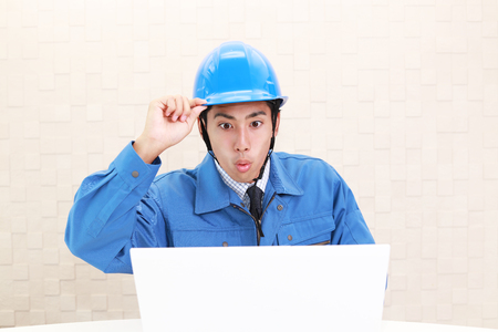 Surprised Asian worker