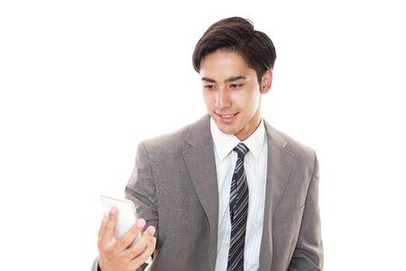 Businessman holding a smart phone Stock Photo