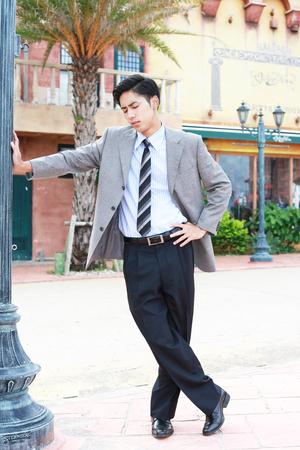 tired businessman: Depressed Asian businessman