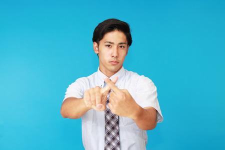 tired businessman: Businessman demonstrating prohibiting gesture Stock Photo