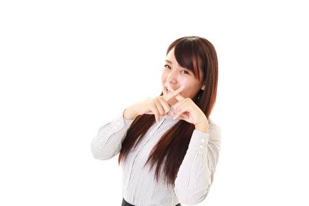 Woman demonstrating prohibiting gesture