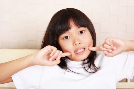 Smiling Asian girl Stock Photo