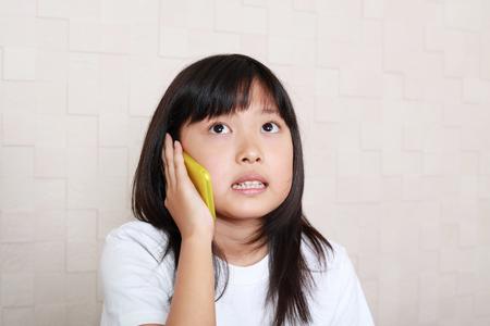 Girl who is talking on a smart phone 版權商用圖片