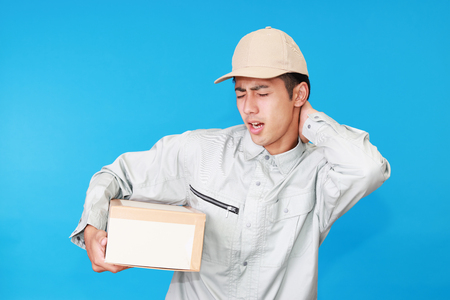 Tired and stressed Asian worker 版權商用圖片