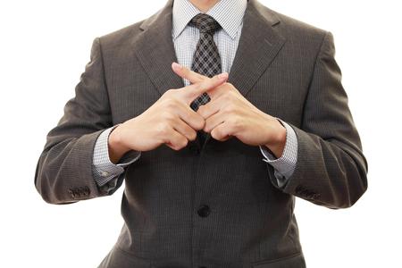 Man demonstrating prohibiting gesture