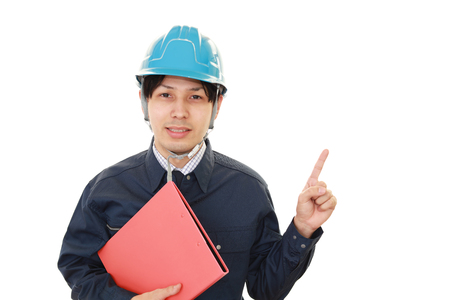 Asian worker pointing