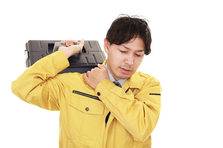 melancholy: An Asian worker on white back ground Stock Photo