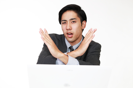 Businessman demonstrating prohibiting gesture Stock Photo