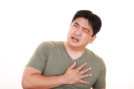 Man having a heart attack isolated on white background