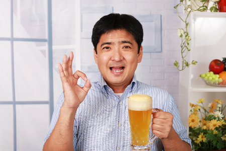 Drunk businessman with beer