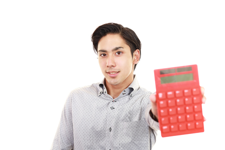 expenditure: Smiling Asian man with a calculator Stock Photo