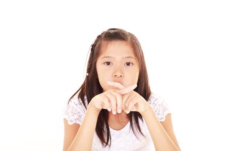 violation: Girl demonstrating prohibiting gesture