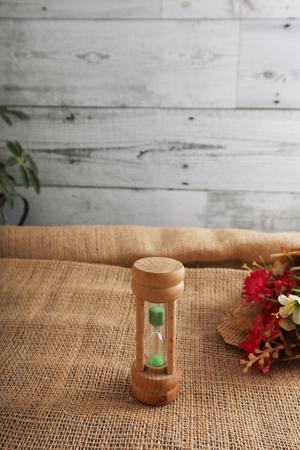Sandglass on hemp cloth