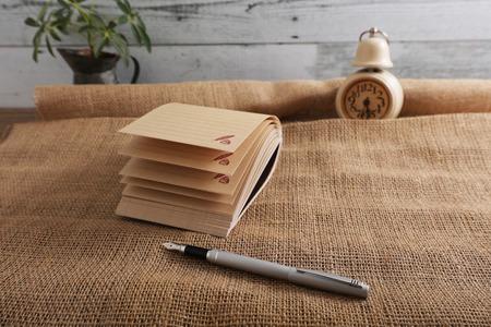 Memo pad with pen Imagens