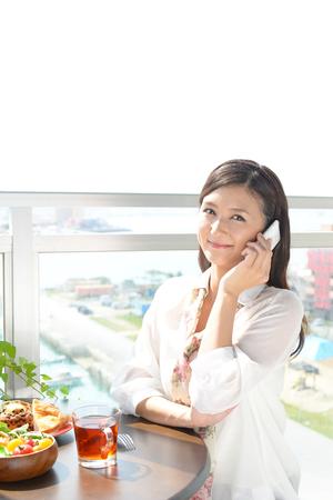 Woman who is talking on a smart phone Standard-Bild