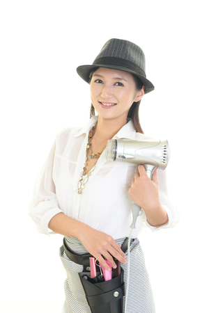 Smiling beautician isolated on white background