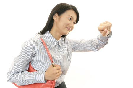 Young woman looking to wrist-watch. Stock Photo