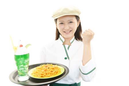 Young waitress serving meals at restaurant