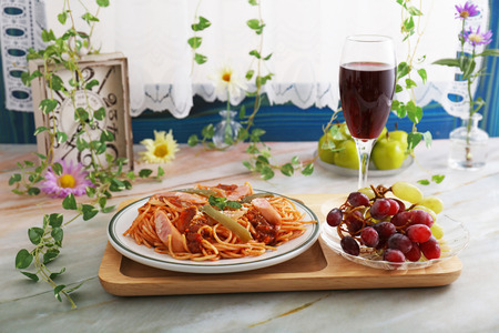Delicious spaghetti and wine on the dining table