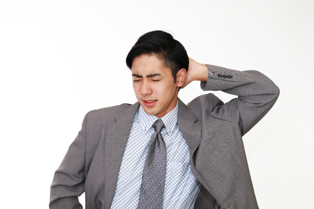 Asian businessman is feeling tired and stressed