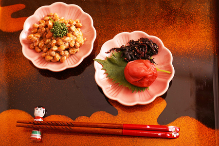Delicious Japanese cuisine on a wooden tray