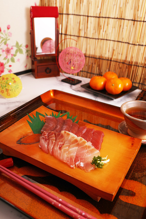 Japanese traditional cuisine sashimi on the wooden plate