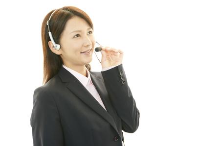 Smiling call center operator Imagens