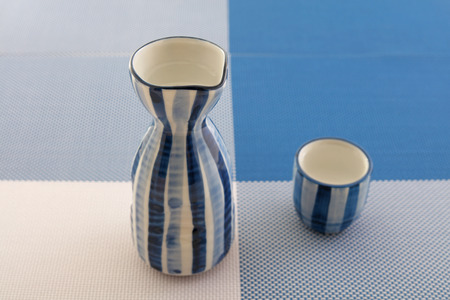 Japanese sake in traditional bottle and cup