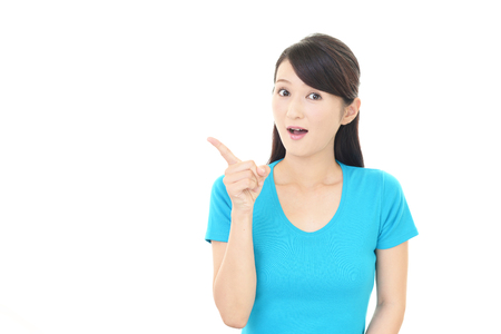 Asian woman pointing with her finger
