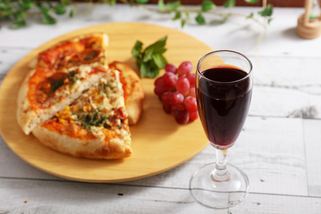 Delicious pizza and a glass of wine