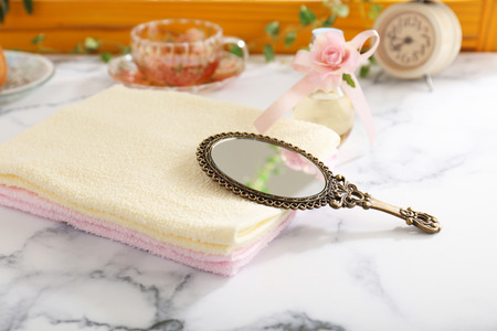 Stylish hand mirror and towels