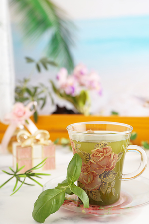 A cup of herbal tea on the dining table