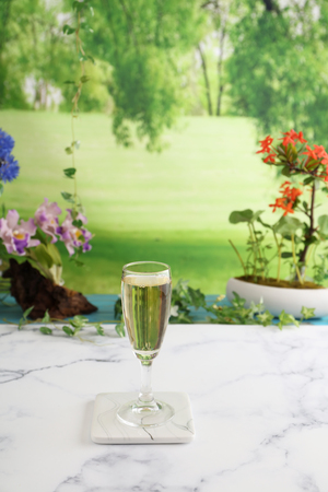 A glass of white wine on the table 版權商用圖片