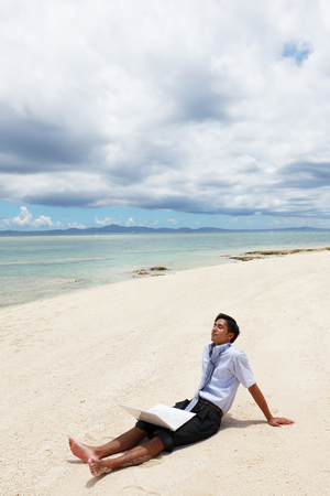The man who relaxes on the beach