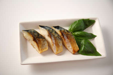 Delicious grilled fish on the plate. 免版税图像