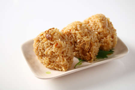 Japanese cuisine rice balls in a dish.