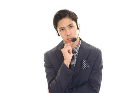 Portrait of telephone operator looking uneasy.