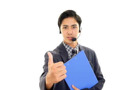 Asian telephone operator showing thumbs up sign