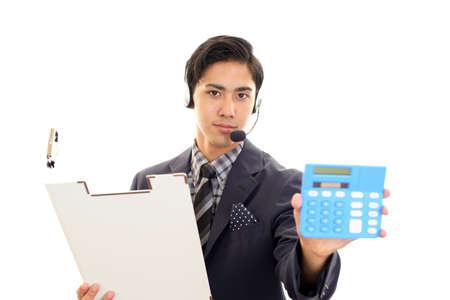 Asian telephone operator holding a calculator